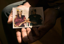Judeson Britto Moses, 28, holds the only photograph he has left of his sister Poline Carmel Moses, Batticaloa, Sri Lanka, Jan. 28, 2005. Moses' sister died along with the rest of his immediate family in the tsunami that hit his beach village.