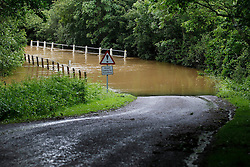 © Licensed to London News Pictures. 11/06/2012, Petworth, UK.  A  flooded road is seen near Petworth, West Sussex, England as continuous rain cause flooding to many area, Monday, June 11, 2012. Photo credit : Sang Tan/LNP