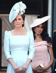 The Duchess of Cambridge (left) and the Duchess of Sussex on the balcony of Buckingham Palace, in central London, following the Trooping the Colour ceremony at Horse Guards Parade as the Queen celebrates her official birthday.
