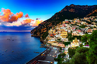 """""""The first light of dawn on Positano""""…<br /> <br /> There was only one occasion that I was able to pre-plan taking photos at sunrise and that was during the last day of three in Positano. It takes much planning, logistics, and familiarity to figure the best locations and the proper angles and positions of the sun. My third morning was ideal and fortuitous as it began raining about 10:00 am which offered perfect clouds for sunrise, finally ending with a very cold wind just in time for sunset. This image is one of the rare photos of a slumbering Positano in the dewing morning around 6:50 am at the end of May….the beginning of peak tourist season. By 8:00 am, this tiny seaside village is bustling with tourists and shop owners, and restaurateurs trying to satisfy every need. All in all, Positano was by far the plushest of all the locations I visited in Italy, and I was blessed to witness everything in full bloom. The primary focal point of Positano is the majestic view of the church of Santa Maria Assunta overlooking the picturesque seaside village. The radiant dome is composed of majolica tiles which are very prominent on the Amalfi Coast. This prominent and resplendent church contains a thirteenth-century Byzantine icon of the legendary Black Madonna. Photogenic is an understatement for Positano, as she poses to perfection graciously revealing le sue bellissime coste!"""