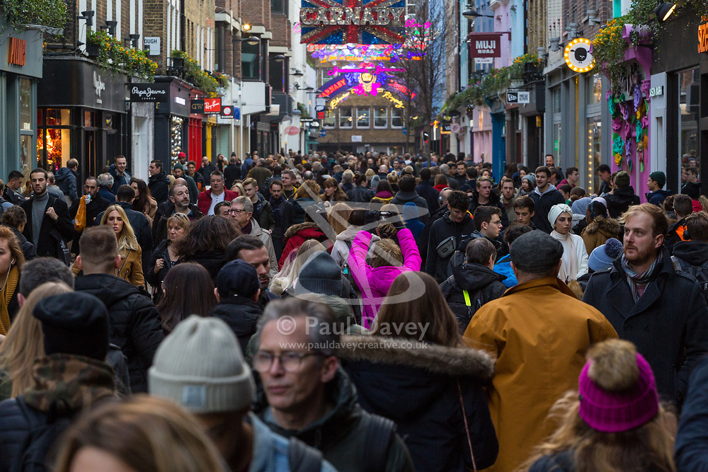 Christmas shoppers fill Carnaby Street in London as the shopping days count down to Christmas. London, December 21 2018.