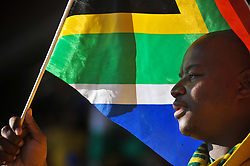 June 11, 2010 - Johannesburg, GAUTENG, SOUTH AFRICA - A fan waves a South African flag during the first game of the 2010 FIFA World Cup which had host nation South Africa playing Mexico to a 1-1 draw Friday, June 11, 2010 at Soccer City in Johannesburg, South Africa. Photo by Bahram Mark Sobhani (Credit Image: © Mark Sobhani/ZUMApress.com)