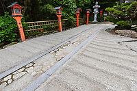 Hieizan Ritsuin Temple Garden, has  been designated as a national scenic spot, but it is usually private and not open to the public except during special exhibition periods. The gardens are made up of a small zen dry karesansui garden by the entrance, mossy pathways with dry stream elements in the central garden as well as a large carp pond adjacent.