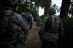 """Paratroopers with Bravo Battery 2-319 2BCT 82nd Airborne Division patrol through the northern neighborhoods of the Adhamiya area  on Monday April 23, 2007. Such areas had not seen regular foot patrols for months or years prior to the begin of the so-called """"surge"""" earlier this year."""