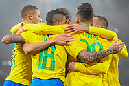 Brazil forward Neymar Jr (10) celebrates with teammates after scoring the first goal of the match during the Friendly International match between Brazil and Uruguay at the Emirates Stadium, London, England on 16 November 2018.