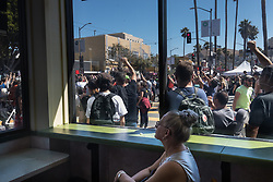 August 26, 2017 - San Francisco, Calif - Tatsianna Vander watchs the rally in a Mission District restaurant during the scheduled Patriot Prayer event on Saturday, Aug. 26, 2017 in San Francisco, Calif. (Credit Image: © Paul Kuroda via ZUMA Wire)