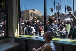 August 26, 2017 - San Francisco, Calif - Tatsianna Vander watchs the rally in a Mission District restaurant during the scheduled Patriot Prayer event on Saturday, Aug. 26, 2017 in San Francisco, Calif. (Credit Image: © Paul Kuroda via ZUMA Wire)