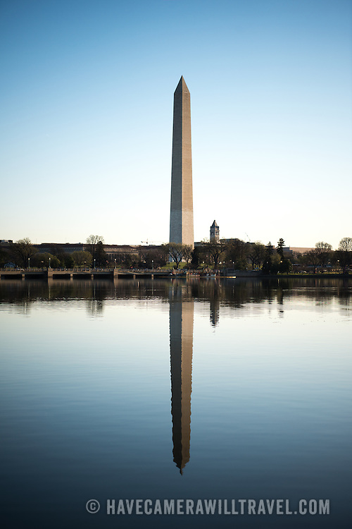 The Washington Monument, standing at the heart of the National Mall, is reflected on the still waters of the nearby Tidal Basin in Washington DC.