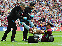 Football - 2018 / 2019 EFL Sky Bet Championship Play-Off Final - Aston Villa vs. Derby County<br /> <br /> Tyrone Mings of Villa gets treatment for cramp in both legs, at Wembley Stadium.<br /> <br /> COLORSPORT/ANDREW COWIE