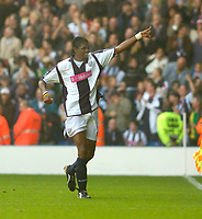 Photo: Leigh Quinnell.<br /> West Bromwich Albion v Arsenal. The Barclays Premiership.<br /> 15/10/2005. West Broms Nwankwo Kanu celebrates his goal.