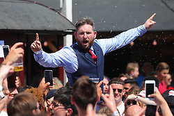 © Licensed to London News Pictures. 07/07/2018. London, UK. An England fan dressed as England Manager Gareth Southgate rallies the crowd as they wait for the start of the England v Sweden World Cup Quarter Final match as it is shown on the big screen at Flat Iron Square in London. Photo credit: Rob Pinney/LNP