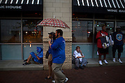 People shield themselves from the rain during the 2012 Democratic National Convention on Monday, September 3, 2012 in Charlotte, NC.