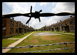 19 June, 2006. New Orleans, Louisiana. Housing problems. Keep Out! Saint Bernard Housing complex. The eerily deserted 1,300 unit housing project was flooded in the aftermath of hurricane Katrina. HANO, The Housing Authority of New Orleans has vowed to demolish the public housing, once riddled with crime and poverty. The housing authority proposes a mix of private and public housing created by private contractors. Former residents, fenced out with barbed wire argue that HANO is part of a greater city plot to keep poor, predominantly African Americans from returning home. The Complex is now fenced off and residents need to make an appointment at least 72 hours in advance to be permitted back to collect personal belongings.