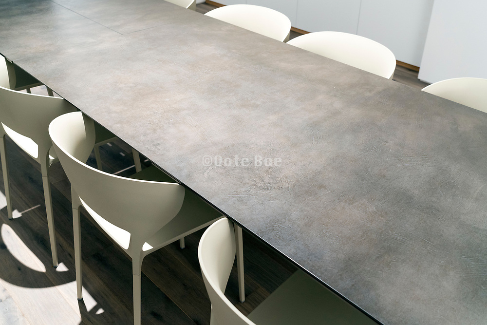 long table with modern chairs