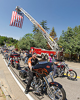 Riders depart from the Naswa Resort for the annual Makris Memorial Ride around Lake Winnipesaukee on Saturday morning.  (Karen Bobotas/for the Laconia Daily Sun)
