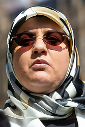 © Licensed to London News Pictures. 10/05/2018. London, UK. Fatima Boudchar addresses the media outside Parliament after Attorney General Jeremy Wright announced that a settlement had been reached over her 2004 rendition to Libya. Fatima Boudchar and her husband, Abdel Hakim Belhaj, were kidnapped in Thailand in 2004 and flown to Libya in a rendition operation, allegedly with the help of MI6. Photo credit: Rob Pinney/LNP