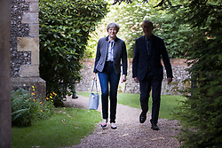 © Licensed to London News Pictures. 28/05/2017. Reading, UK. Prime Minister Theresa May and her husband Philip  attend church near her constituency as campaigning in the general election is set to resume after the Manchester bomb. Photo credit: Peter Macdiarmid/LNP