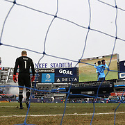 NEW YORK, NEW YORK - March 18:  Rodney Wallace #23 of New York City FC is shown on the stadium screen as he celebrates with team mate Ronald Matarrita #22 of New York City FC after scoring as goalkeeper Evan Bush #1 of Montreal Impact stands dejected during the New York City FC Vs Montreal Impact regular season MLS game at Yankee Stadium on March 18, 2017 in New York City. (Photo by Tim Clayton/Corbis via Getty Images)