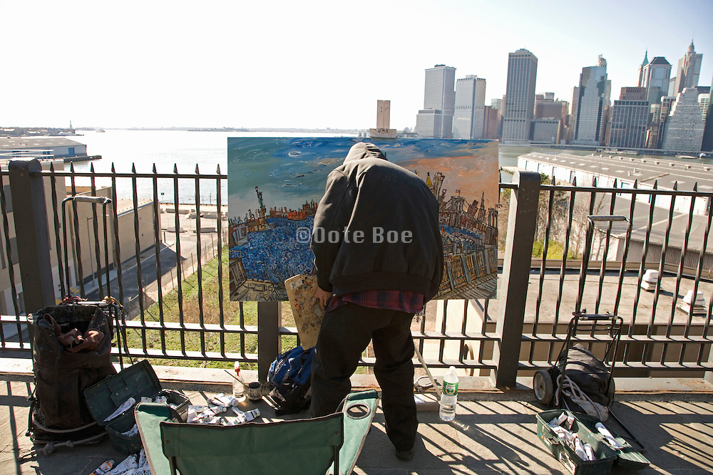 painter painting skyline of New York City