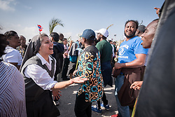 """14 April 2019, Jerusalem: A Sister acts as cheerleader to a group of pilgrims, chanting 'Jesu! Jesu, Jesu, Jesu! ..."""" as if were they at a football game. On Palm Sunday, thousands gathered and marched from the Mount of Olives down to the Old City of Jerusalem, following in the footsteps of Jesus, as he journeyed to Jerusalem."""