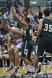 17 December 2011:  Nick Anderson uses the baseline to move underneath for a shot during an NCAA mens division 3 basketball game between the Washington University Bears and the Illinois Wesleyan Titans in Shirk Center, Bloomington IL