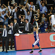 Anadolu Efes's Dogus Balbay (F) celebrate victory during their Turkish Airlines Euroleague Basketball Group A Round 5 match Anadolu Efes between Real Madrid at Abdi ipekci arena in Istanbul, Turkey, Thursday, November 14, 2014. Photo by Aykut AKICI/TURKPIX