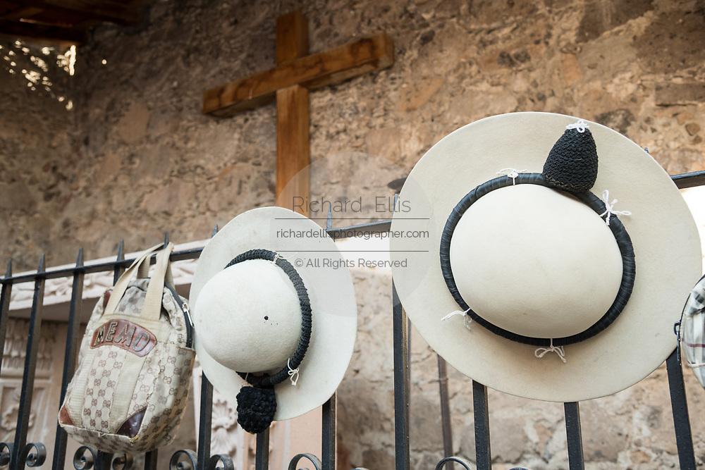 Mexican Picador hats hang from the Matador chapel at the Plaza de Toros in San Miguel de Allende, Mexico.