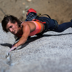 Anne Giles climbing Crime of the Century 5.11c at Penny Lane in the Smoke Bluffs, Squamish, BC
