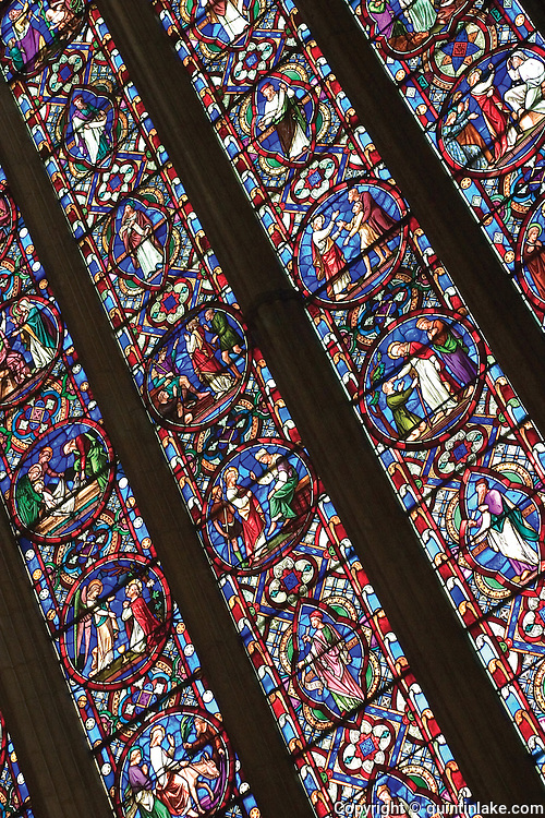 Detail of Lincoln Cathedral East window showing The Creation and Redemption of Man. Stained glass by Ward and Nixon, 1855. Lincoln, UK, 2004