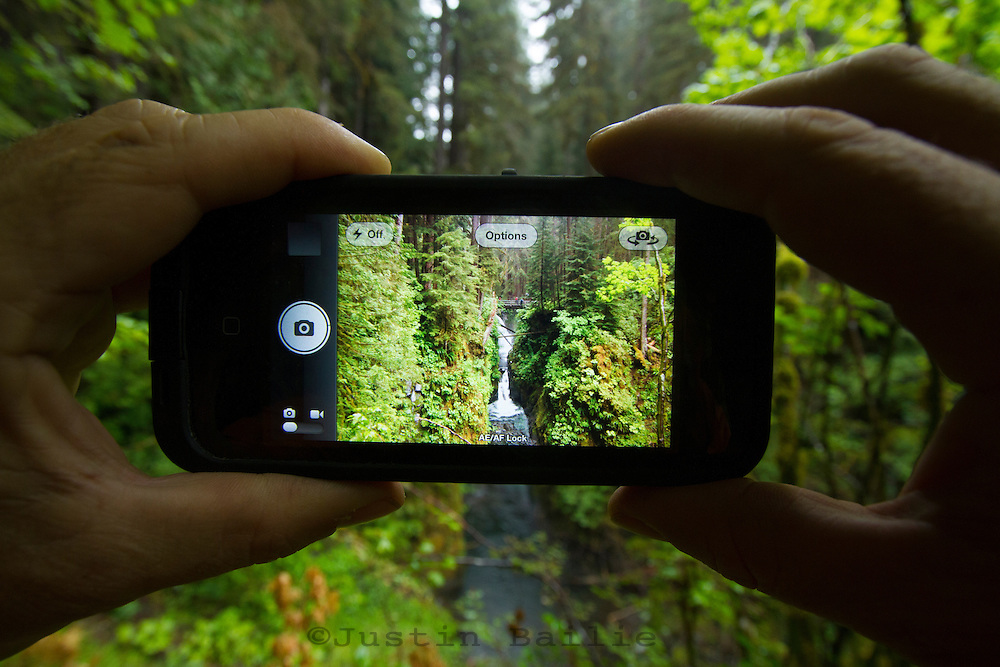 Taking an iphone photo of the Sol Duc Falls, Sol Duc River, Olympic National Park, WA
