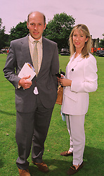 MR & MRS PEREGRINE ARMSTRONG-JONES he is the half brother of the Earl of Snowdon former husband of Princess Margaret, at a polo match in Sussex on 19th July 1998.MJD 63