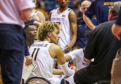 Dec 1, 2019; Morgantown, WV, USA; West Virginia Mountaineers forward Emmitt Matthews Jr. (11) listens to West Virginia Mountaineers head coach Bob Huggins during a timeout during the second half against the Rhode Island Rams at WVU Coliseum. Mandatory Credit: Ben Queen-USA TODAY Sports