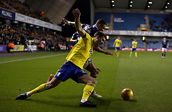 Birmingham City's Gary Gardner and Millwall's James Meredith in action