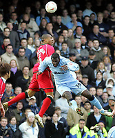 Photo: Paul Thomas. Coventry City v Cardiff City, Highfield Road, Coventry,  Coca Cola Chamionship. 12/03/2005. Daniel Gabbidon and Trevor Benjamin go for the ball.