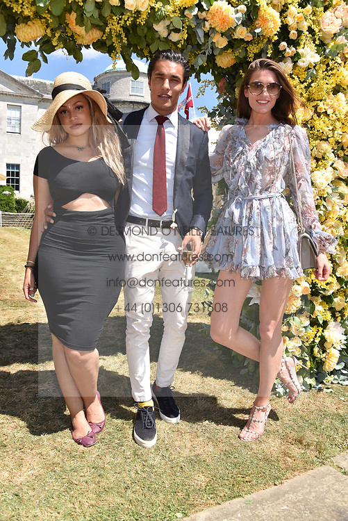 Staz Nair and his fiance and Charlotte Pallister at the 'Cartier Style et Luxe' enclosure during the Goodwood Festival of Speed, Goodwood House, West Sussex, England. 15 July 2018.