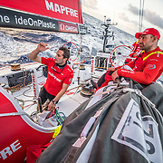 Leg 6 to Auckland, day 07 on board MAPFRE, Blair Tuke talking with Xabi Fernandez on deck. 13 February, 2018.