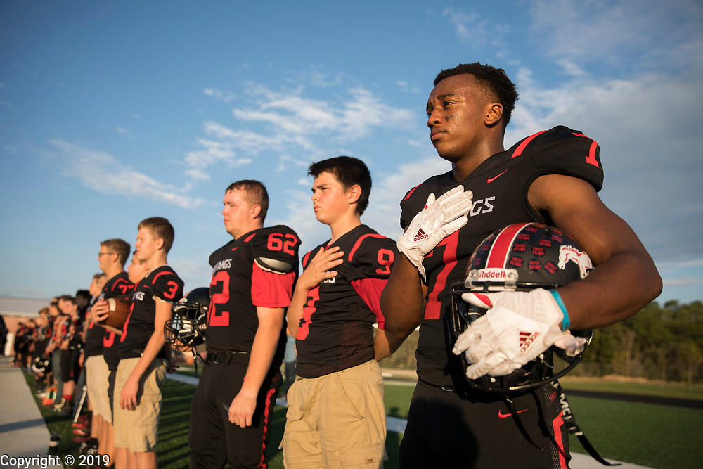 Edgewood football player Levon Bellemy stands during the National Anthem before the Mustangs play Indian Creek, Friday, September 21, 2018 in Ellettsville, Ind.