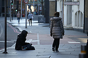 Homeless people in the United Kingdom facing the risk of death from Coronavirus. Last years alone, 320,000 people were recorded as homeless in Britain, analysis from housing charity Shelter suggests. It is a rise of 13,000, or 4%, on last year's figures and equivalent to 36 new people becoming homeless every day.<br /> In this picture, a homeless man is seating at the Toolery Street in central London on Sunday, March 22, 2020. For most people, the new coronavirus causes only mild or moderate symptoms, such as fever and cough. For some, especially older adults and people with existing health problems, it can cause more severe illness, including pneumonia. <br /> (Photo/Vudi Xhymshiti)