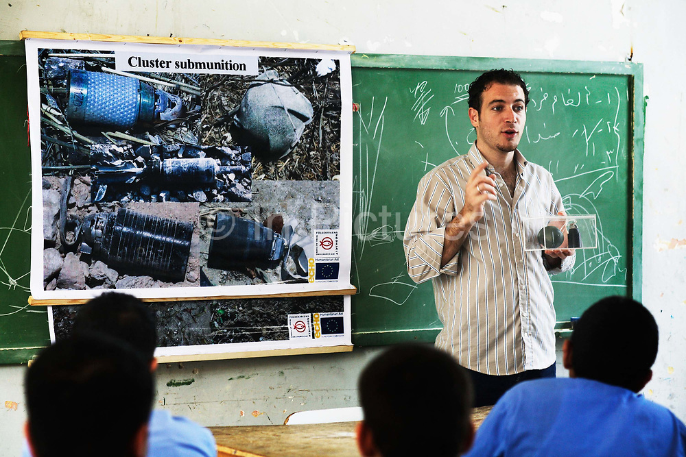 Ahmed working for the Danish NGO Danish Church Aid teaches children about the dangers of cluster bombs.  Here in the school of Akka in Saidon, South Lebanon.