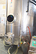 Stainless steel fermentation tank with stirring and cooling equipment. Vukoje winery, Trebinje. Republika Srpska. Bosnia Herzegovina, Europe.