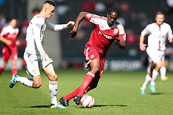 Swindon Town's Nile Ranger is challenged by Milton Keynes Dons' Shaun Williams  - Photo mandatory by-line: Nigel Pitts-Drake/JMP - Tel: Mobile: 07966 386802 07/09/2013 - SPORT - FOOTBALL -  Stadium MK - Milton Keynes - Milton Keynes V Swindon Town - Sky Bet League one