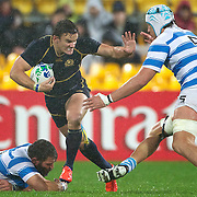Max Evans, Scotland, fends off Patricio Albacete, Argentina, during the Argentina V Scotland, Pool B match at the IRB Rugby World Cup tournament. Wellington Regional Stadium, Wellington, New Zealand, 25th September 2011. Photo Tim Clayton...