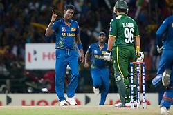 © Licensed to London News Pictures. 04/10/2012. Sri Lankan Angelo Mathews lifts his finger after getting Kamran Akmal out during the World T20 Cricket Mens Semi Final match between Sri Lanka Vs Pakistan at the R Premadasa International Cricket Stadium, Colombo. Photo credit : Asanka Brendon Ratnayake/LNP