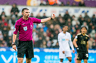 Referee Mike Oliver looks on.. Premier league match, Swansea city v Leicester city at the Liberty Stadium in Swansea, South Wales on Saturday 21st October 2017.<br /> pic by Aled Llywelyn, Andrew Orchard sports photography.