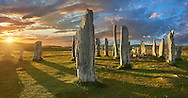 Panorama of  the central stone circle, at sunset, erected between 2900-2600BC measuring 11 metres wide. At the centre of the ring stands a huge monolith stone 4.8 metres high weighing about 7 tonnes, which is perfectly orientated so that its widest sides face due north south. Calanais Neolithic Standing Stone (Tursachan Chalanais) , Isle of Lewis, Outer Hebrides, Scotland. .<br /> <br /> Visit our SCOTLAND HISTORIC PLACXES PHOTO COLLECTIONS for more photos to download or buy as wall art prints https://funkystock.photoshelter.com/gallery-collection/Images-of-Scotland-Scotish-Historic-Places-Pictures-Photos/C0000eJg00xiv_iQ<br /> '<br /> Visit our PREHISTORIC PLACES PHOTO COLLECTIONS for more  photos to download or buy as prints https://funkystock.photoshelter.com/gallery-collection/Prehistoric-Neolithic-Sites-Art-Artefacts-Pictures-Photos/C0000tfxw63zrUT4