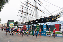 © Licensed to London News Pictures. 03/10/2021. London, UK. Runners run past the Cutty Sark during the London Marathon 2021. Photo credit: Ray Tang/LNP