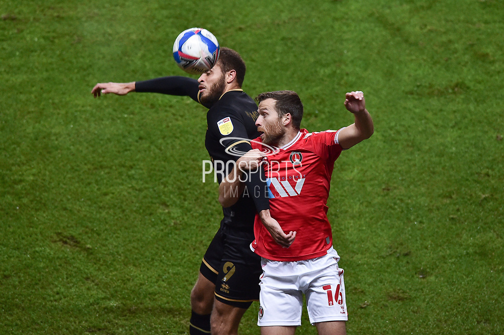 MK Dons' Forward Carlton Morris (9) and Charlton Athletic defender Adam Matthews (16) battles for possession in a header during the EFL Sky Bet League 1 match between Charlton Athletic and Milton Keynes Dons at The Valley, London, England on 2 December 2020.