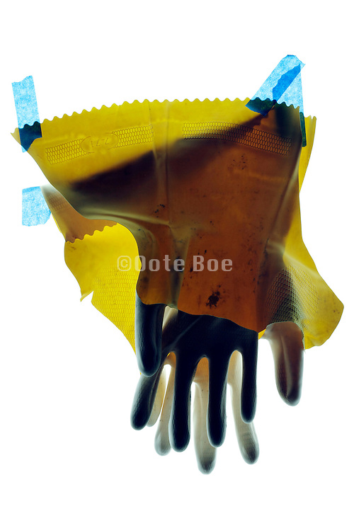 broken household working gloves with blue tape
