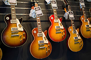 Vintage custom Gibson Les Paul guitars in various colours at a guitar shop in London, United Kingdom.