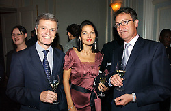 Left to right, BERNARD PEILLON President of Champagne Ruinart, YASMIN MILLS and GEORGE ATKINSON-CLARK UK MD of Champagne Ruinar at a party hosted by Ruinart Champagne at Claridges, Brook Street, London on 18th October 2006.<br />